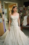 Meredith Grey trying on wedding dresses in Izzie's hospital room.